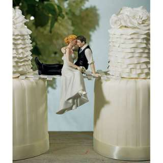 Perfect romantic cake topper. Caught sneaking a kiss, this laid back