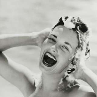 Portrait of Happy Woman Shampooing Hair Photographic Print by Dennis