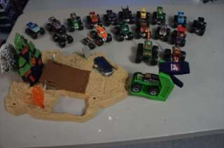 Hot wheels monster truck lot grave digger and playset