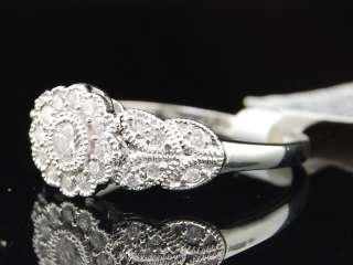 LADIES 10K WHITE GOLD DIAMOND FLOWER ANNIVERSARY RING